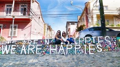 The famous Hippies not Happies street art in Valparaiso