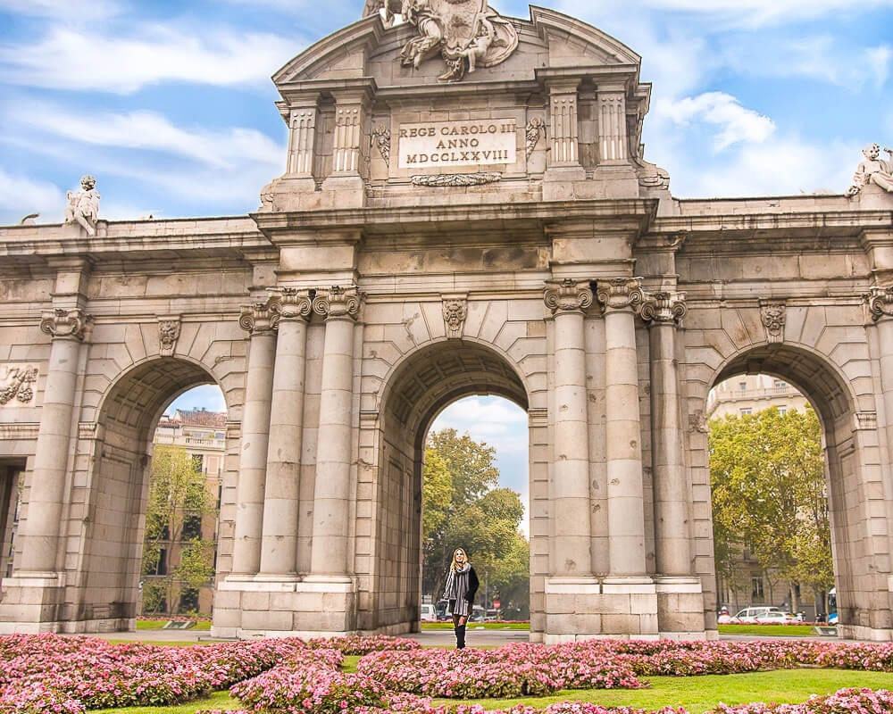 On your walking tour of Madrid, be sure to stop by the Puerta de Alcalá near Retiro.