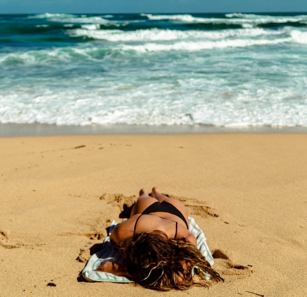 Sun bathing while traveling- use sun protection to prevent skin damage, heat stroke and dehydration.